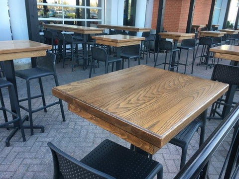 handcrafted wooden tables, restaurant, bar table, outdoor wooden tables. custom built wooden tables,