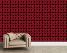 Lavello is a large scale geometric wallpaper. Dark red and black circles.