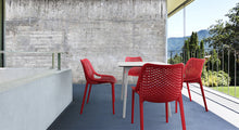 Concrete wallpaper in an indoor patio. Outdoor furniture.