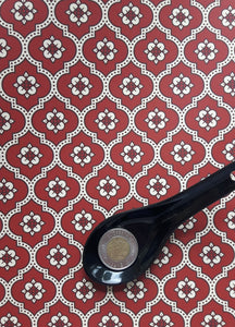 geometric red and white traditional wallpaper pattern.