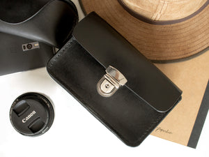 Leather belt bag with tuck lock