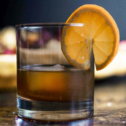 Glass of Sobru Restore with ice and a citrus twist