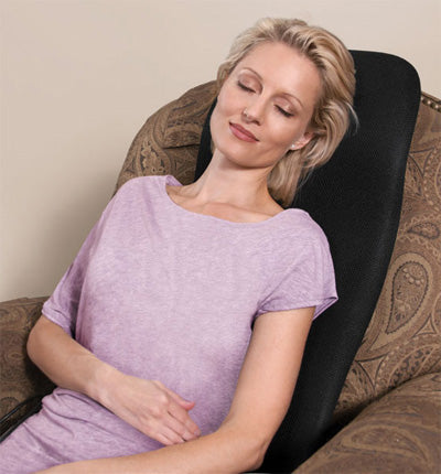 woman sitting in a chair using Vibroacoustic system