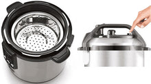 Interior of Breville Fast Slow Cooker with basket in, and pressing pressure release button on its lid