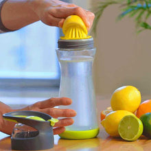 Wherever Lemon Water Glass Bottle with lid off and a lemon on its reamer