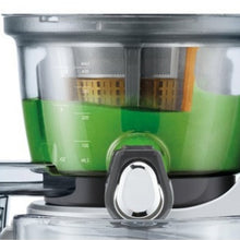 Close-up of The Big Squeeze spout plug which enables pre-mixing juice