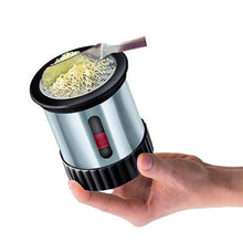 Cooks Innovation Butter Mill with metal casing in use