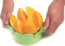 Load image into Gallery viewer, using a Norpro Grip-EZ Wedger to slice an orange into wedges