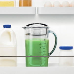 Breville Juice Fountain Cold Seal and Store Juice Jug shown filled in a fridge shelf