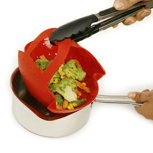 Removing Norpro Silicone Steamer Basket with locking handles after use with tongs