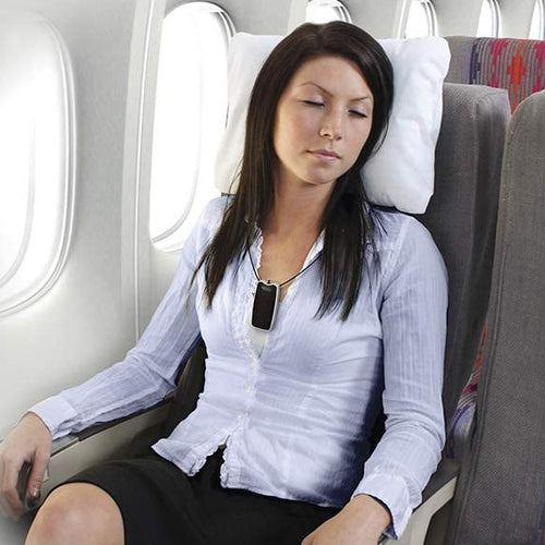 Woman Using AirTamer on an Airplane