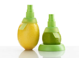 A lemon and lime with Lekue Silicone Citrus Spray Extractors inserted