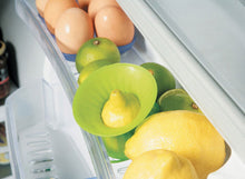 Load image into Gallery viewer, Lekue Lemon Press being used to store leftover lemon in fridge