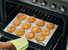 Load image into Gallery viewer, Remving the Lekue Non-Stick Silicone Baking Mat after baking
