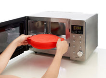 Load image into Gallery viewer, Placing a Lekue Spanish Omelette Maker in a microwave