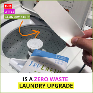 inserting a Tru Earth Eco-Strip into a washer