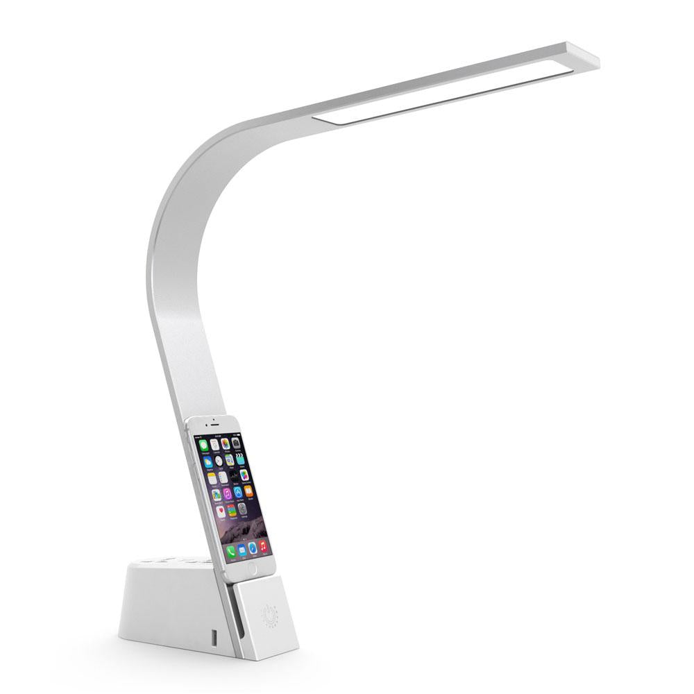 The sleek and durable Brooklyn AC LED Task Lamp creates a new standard of elegance for task lighting. Featuring two international power outlets, two USB ports at its base, and three touch-activated brightness levels, this powerhouse effortlessly transforms from vivid workspace lamp to gentle reading lamp. Its minimalist form incorporates LED light panel technology to cast energy-efficient, warm, white light.