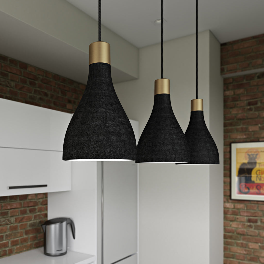 Close up of three charcoal La Brea LED pendant lights hanging in a brick kitchen