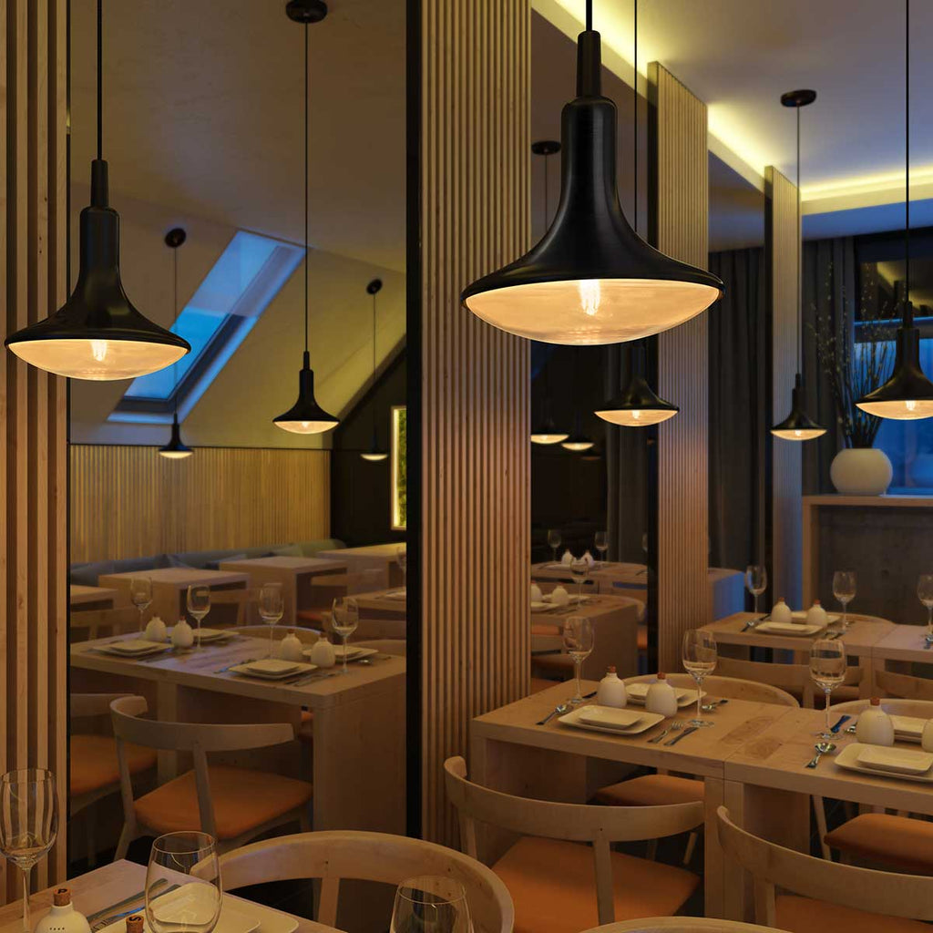 Satin black droplet LED pendant lights hanging over fancy restaurant tables