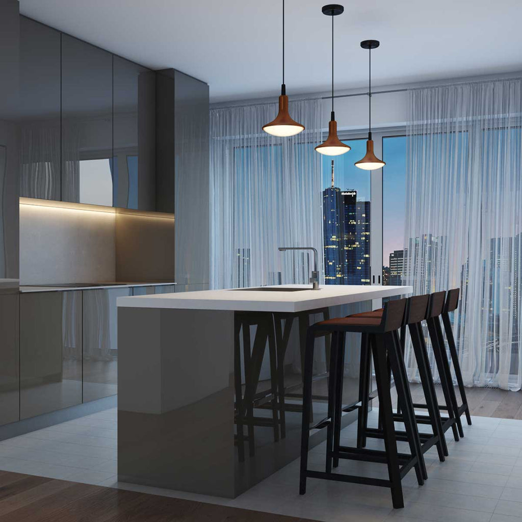Three copper droplet LED pendant lights hanging over a high top kitchen counter overlooking the city
