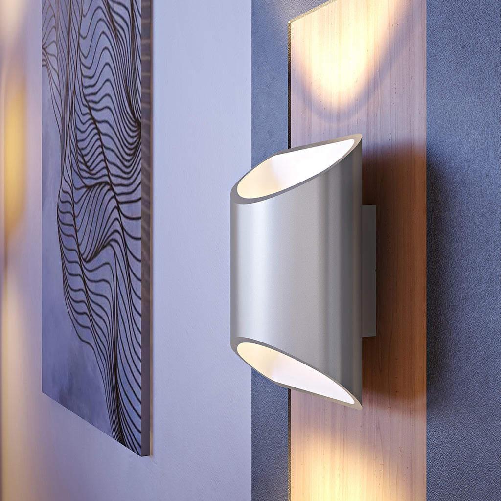 Close view of a brushed aluminum Brooklyn LED wall sconce mounted on a wall