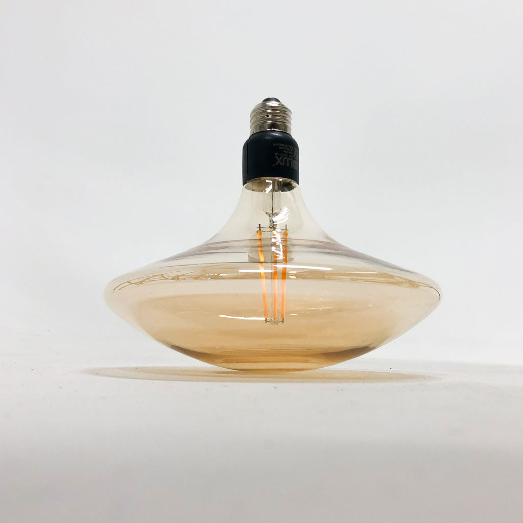 Close up side view of droplet LED pendant light bulb