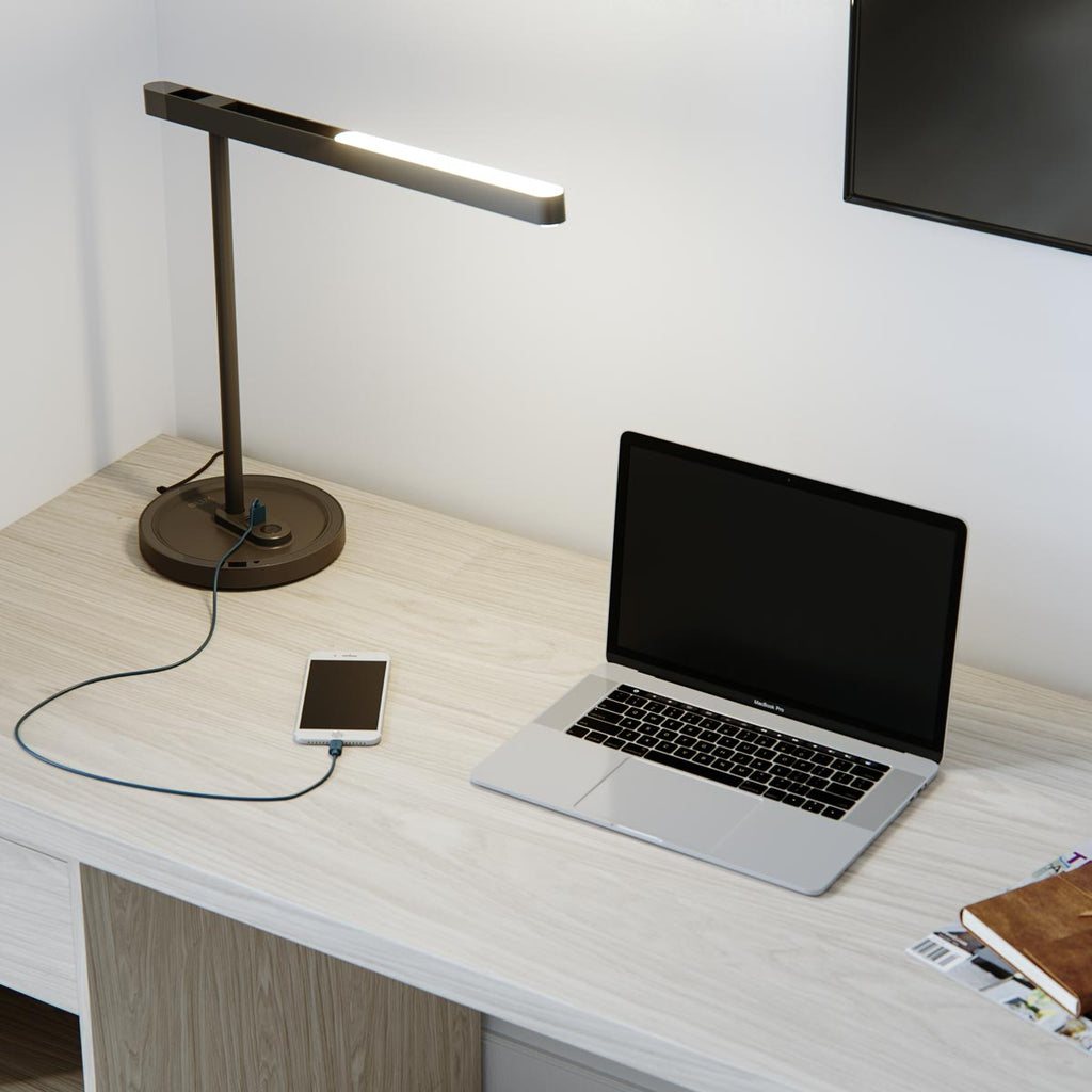 highline LED desk lamp in black matte and chrome with two USB charging ports charging phone
