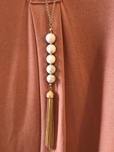 Straight line white beaded gold tassel necklace