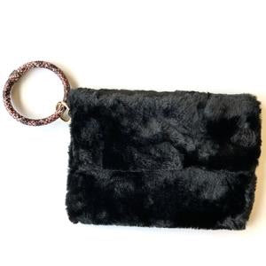 Faux fur clutch with snakeskin bracelet handle