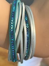 Teal sparkle arm party