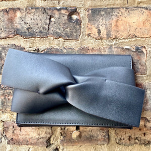 Black bow clutch