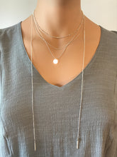Layered necklace with split tassels