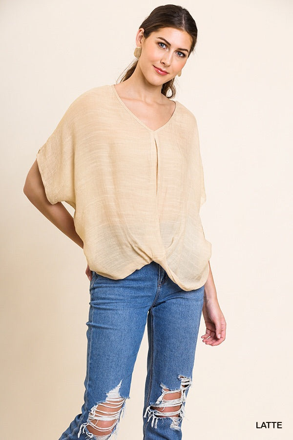 Sheer short sleeve top with front twist