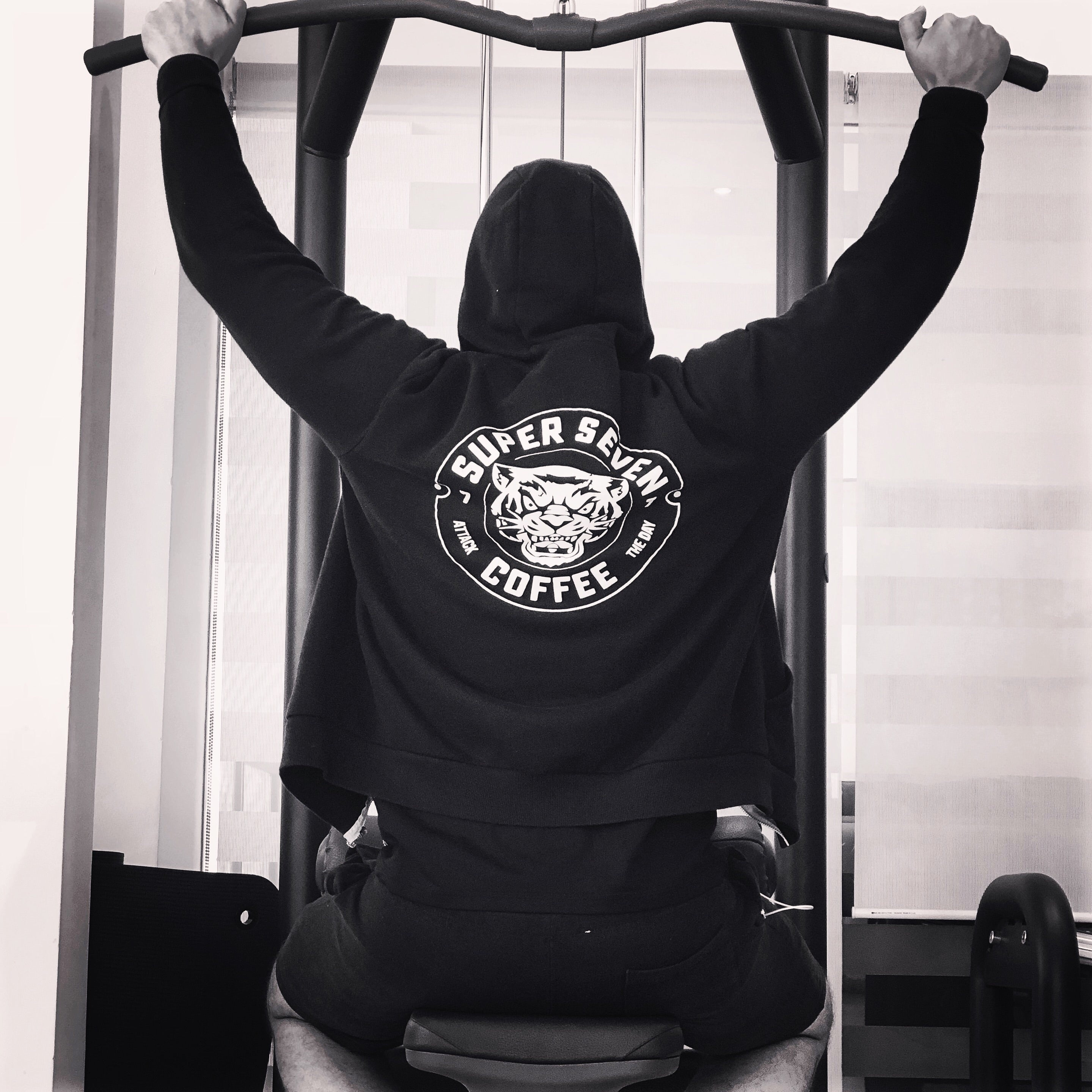 Man in Gym wearing Black Hoodie