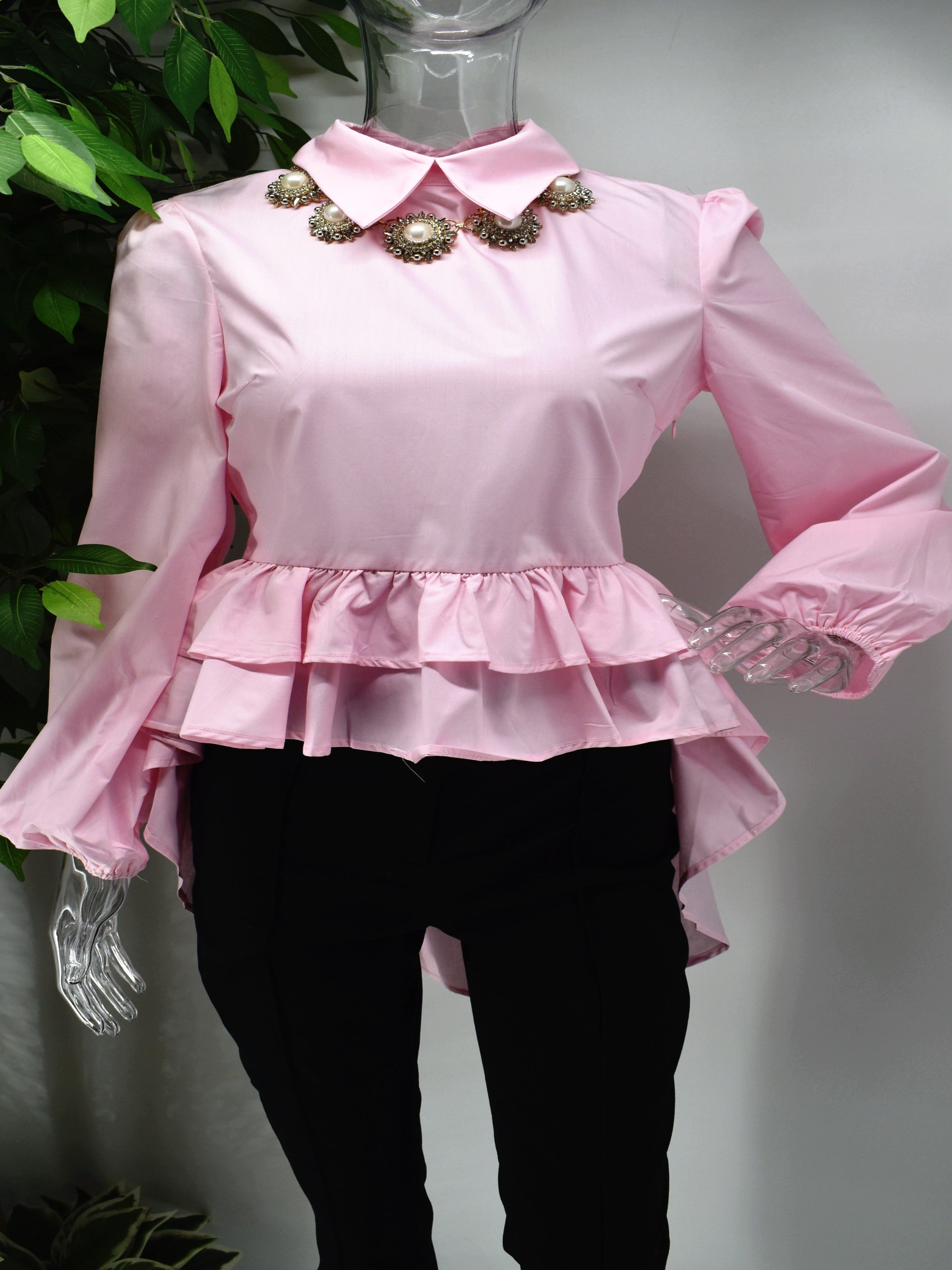 Fashion forward yet comfortably chic is what our Brier pink shirt Blouse will deliver.  Brier is a pink shirt blouse with a ruffled peplum waistline with the back hem longer than the front.