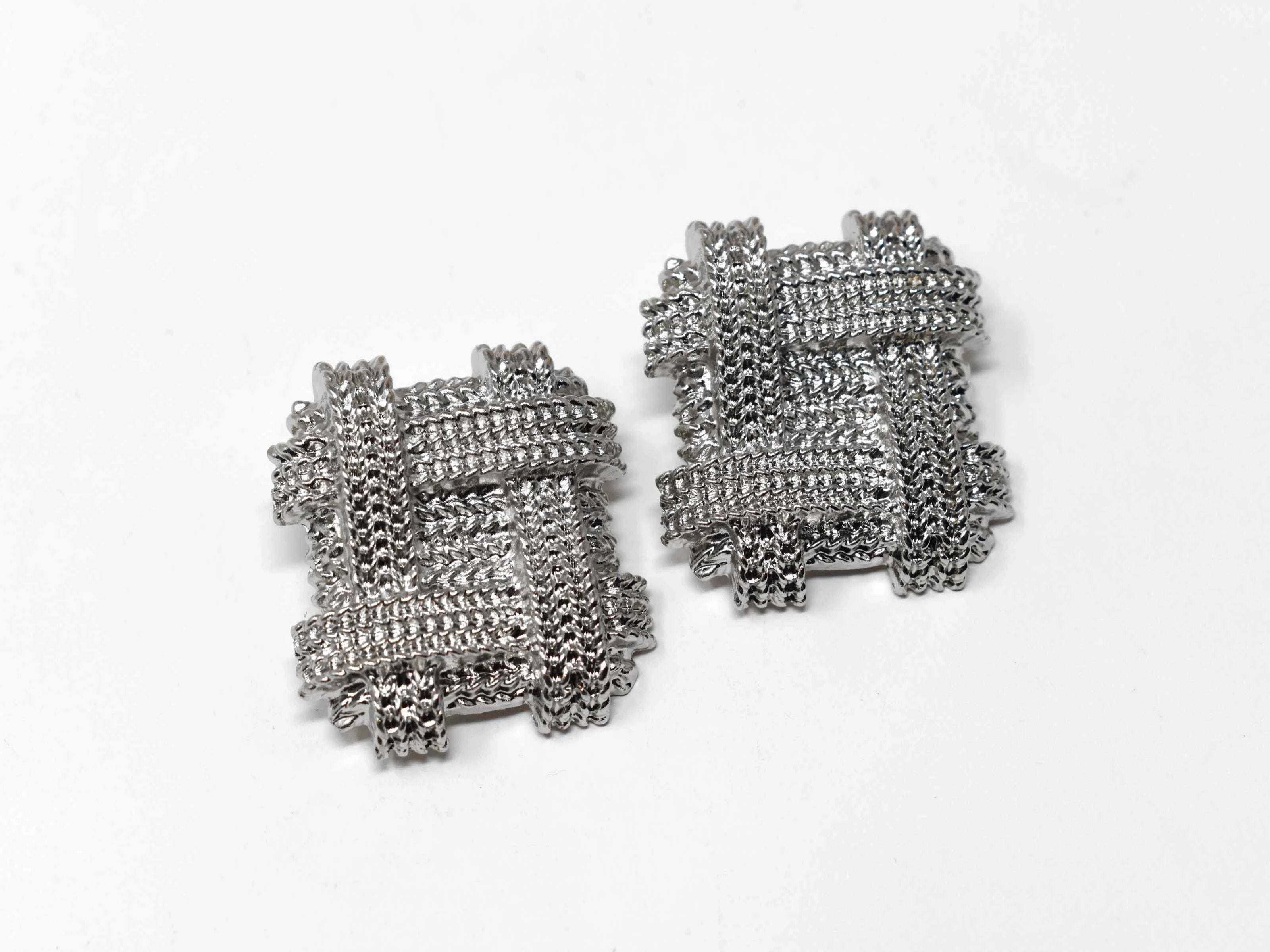 "Our Ane silver earrings Chic design will showcase your standout style with its unique chain design. These oversized square knobs 1 1/2"" in length with a clip back clasp. All hail the clip ons!"