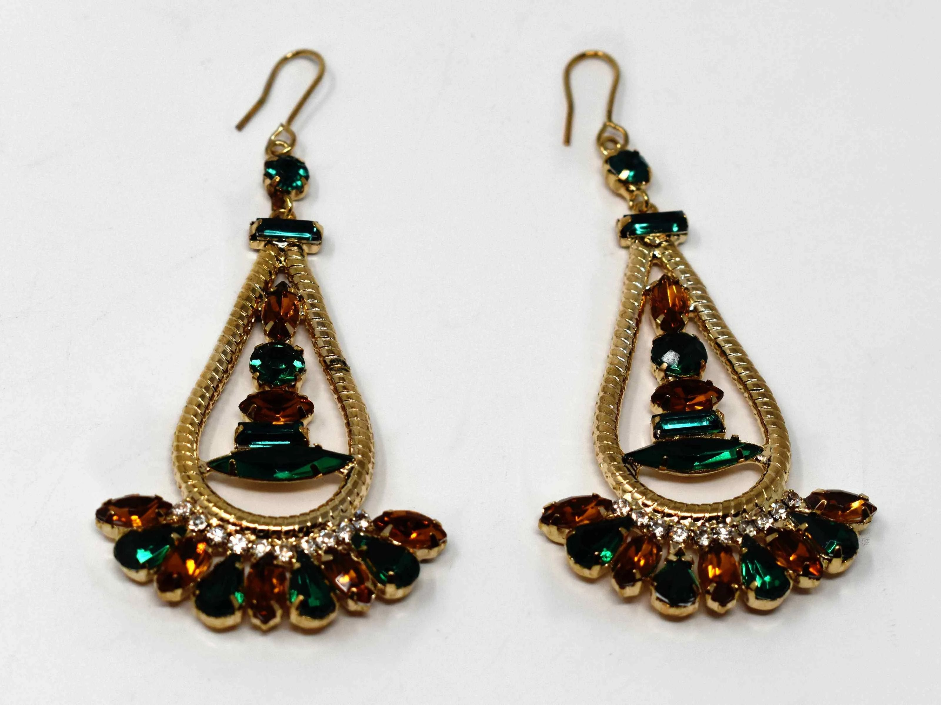 Anemone is a gold with a bronze and green stone eye catching drop , dangle style earring. It comes with a fish hook clasp and is 3 inches in length.