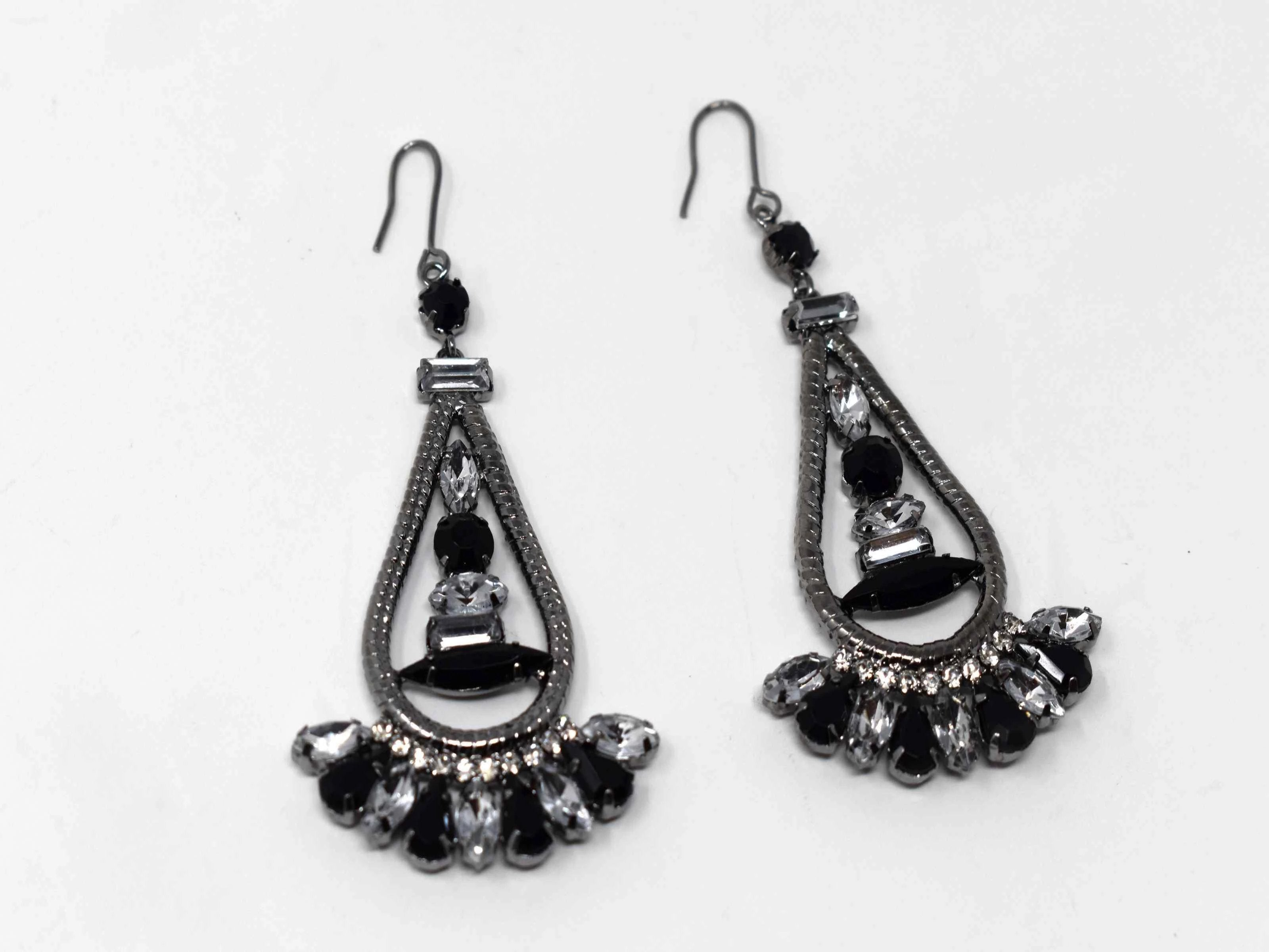 Anemone is a silver with clear  and black stone eye catching drop , dangle style earring. It comes with a fish hook clasp and is 3 inches in length.
