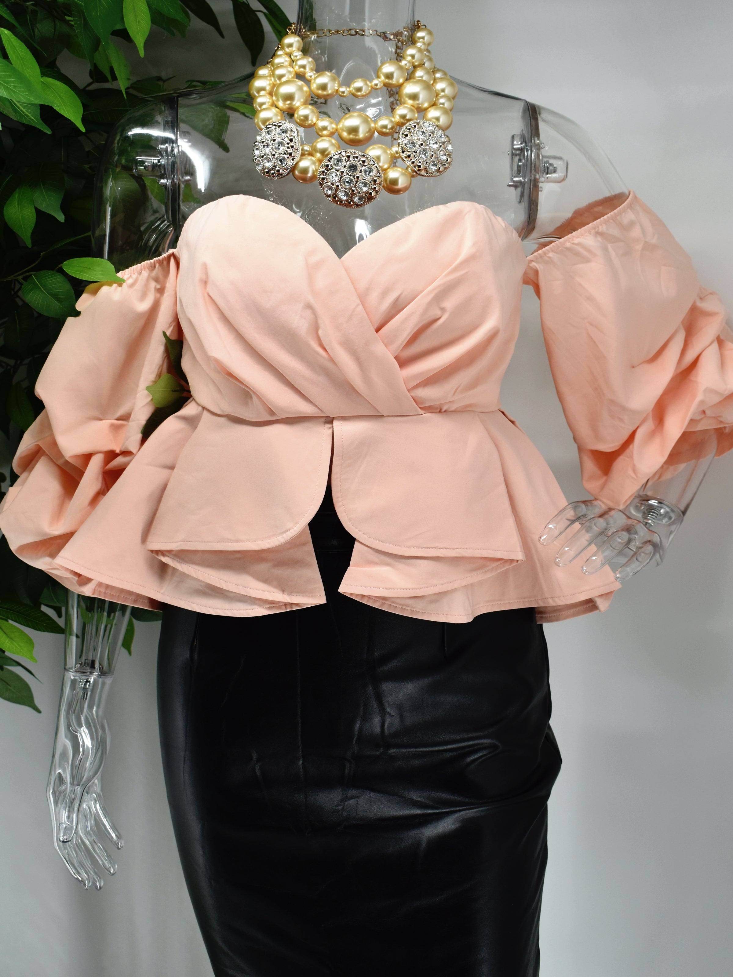 Dont just talk the talk be about this fashion life in our Babita ruffle peplum top. Our Babita has a uniquely designed peplum ruffled waist , sweetheart neckline and balloon sleeves.