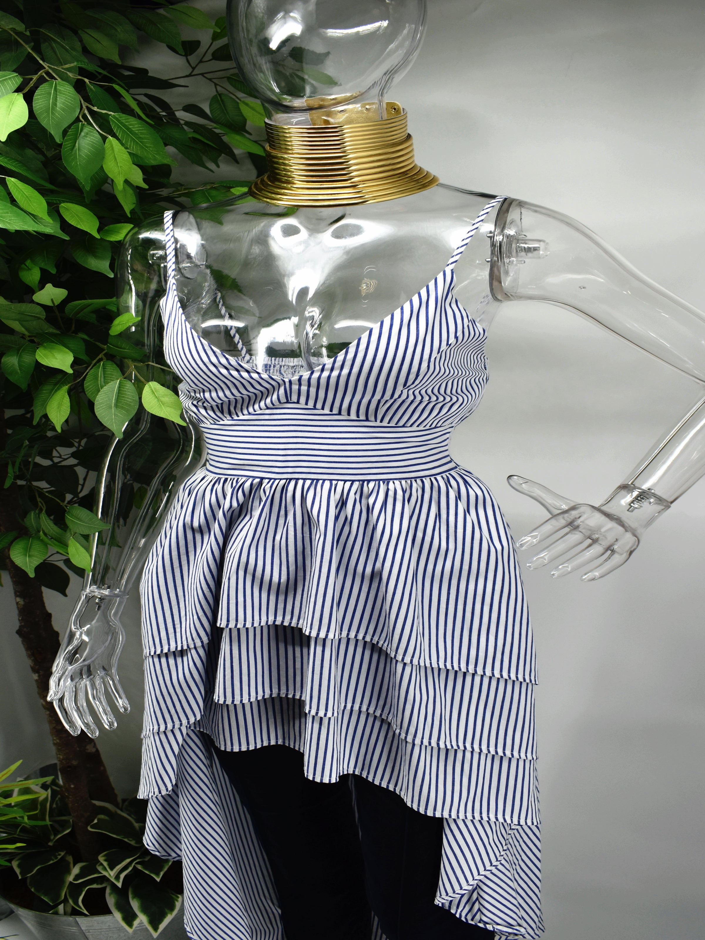 You wont regret taking a chance on our Barbette Stripe Top.  Our Barbette blue and white stripe top is a beauty for most occasions. It has a sweetheart neckline accompanied by spagetti straps which falls into a peplum tiered hemline.