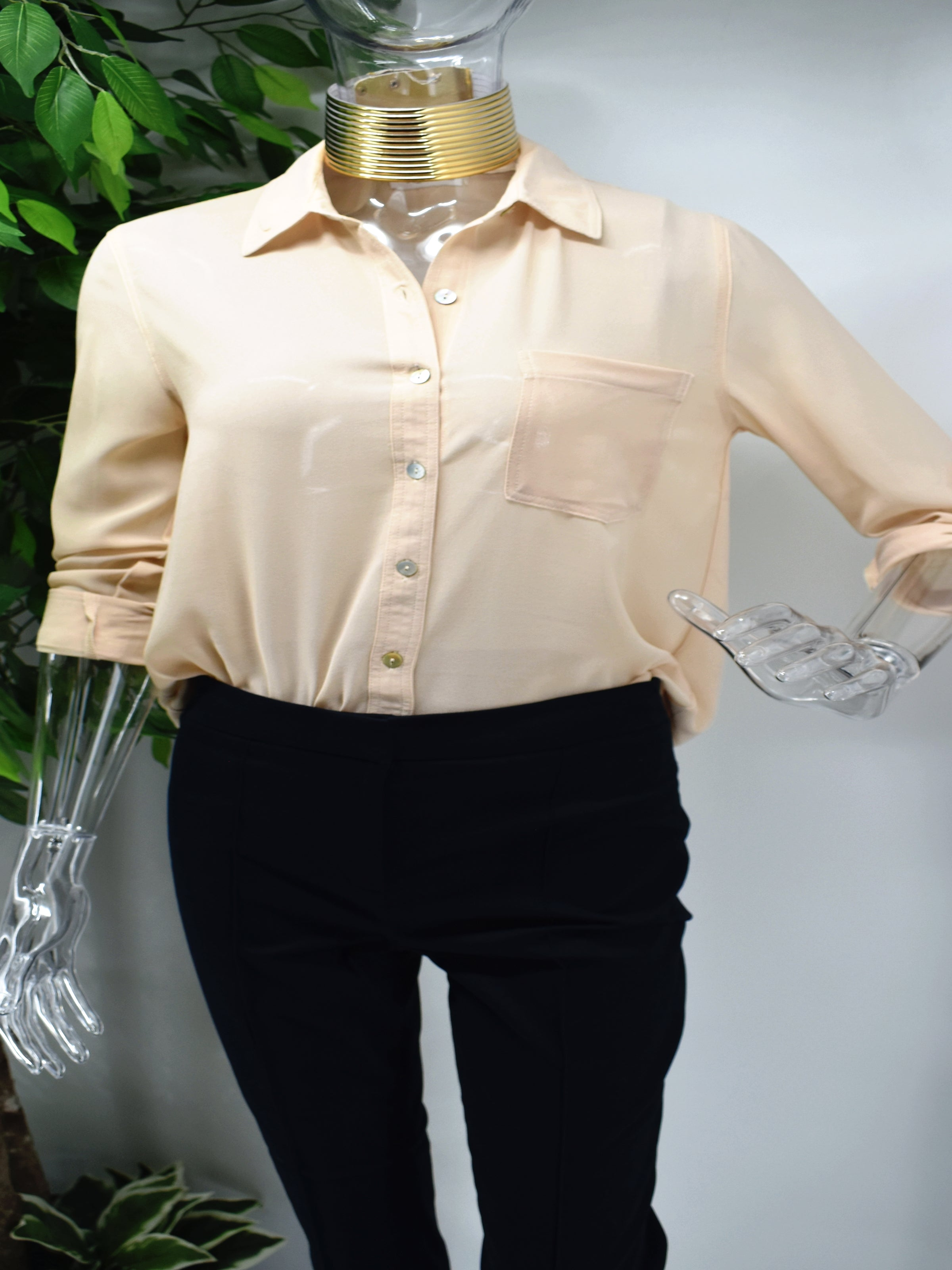 Enjoy an elegant design that never fades with our classic Bayla shirt blouse. Our Bayla is a beige button front shirt blouse loose in fit with a classic rolled cuffed sleeve.