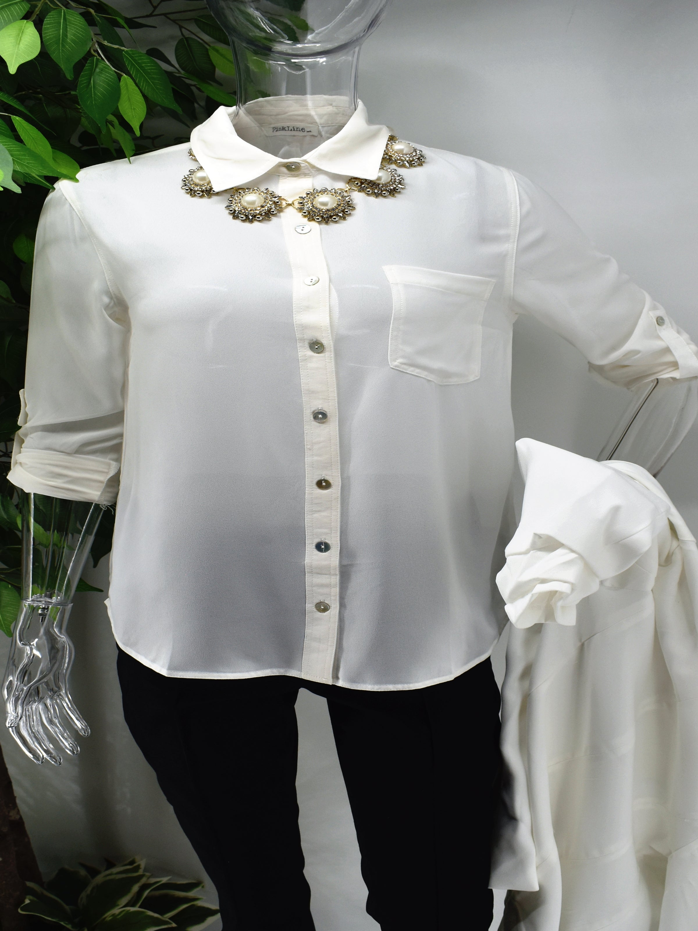 Enjoy an elegant design that never fades with our classic Bayla shirt blouse. Our Bayla is a white button front shirt blouse loose in fit with a classic rolled cuffed sleeve.