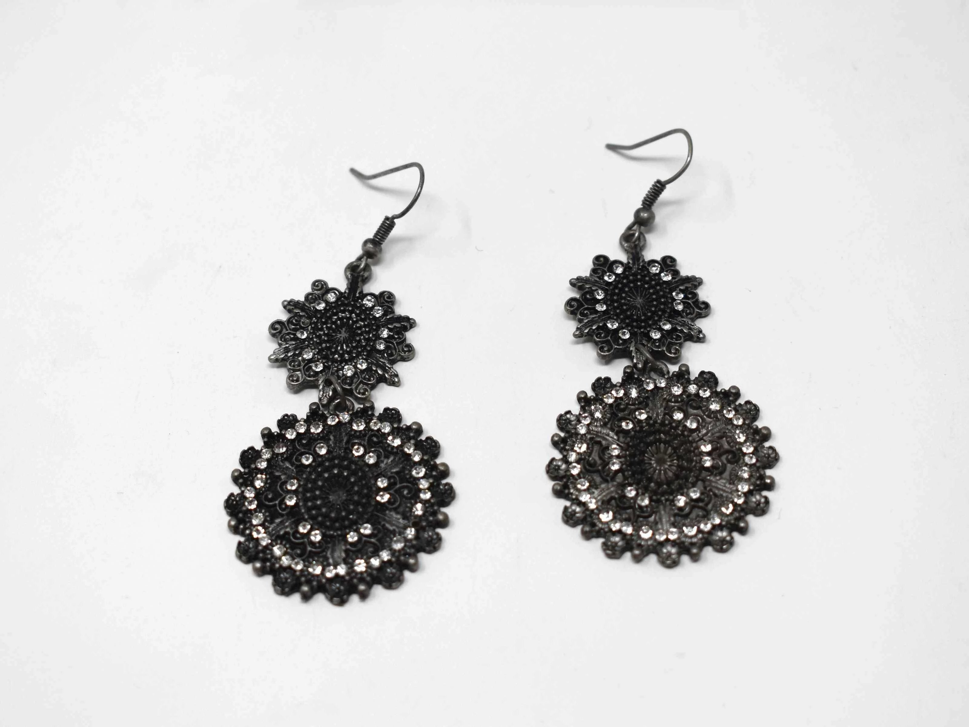 "Our attention getting  Begonia dark silver earrings is an antique styled dangle earring with stones. It measures 2 1/2"" in length and has a fishhook clasp."