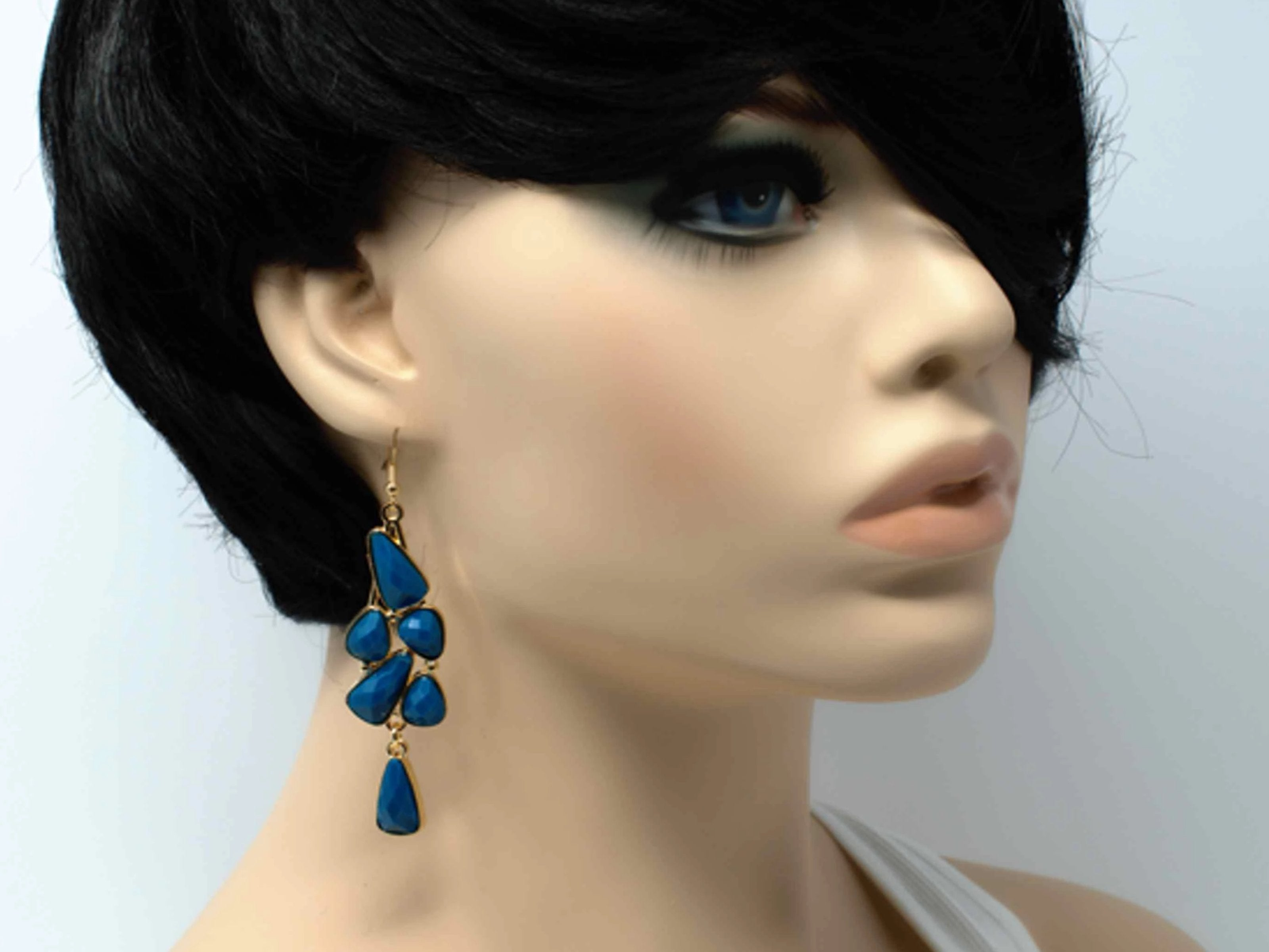 An elegant outstanding gold with turquoise accent stones fashion dangle drop earring. Comes with a fish hook clasp.