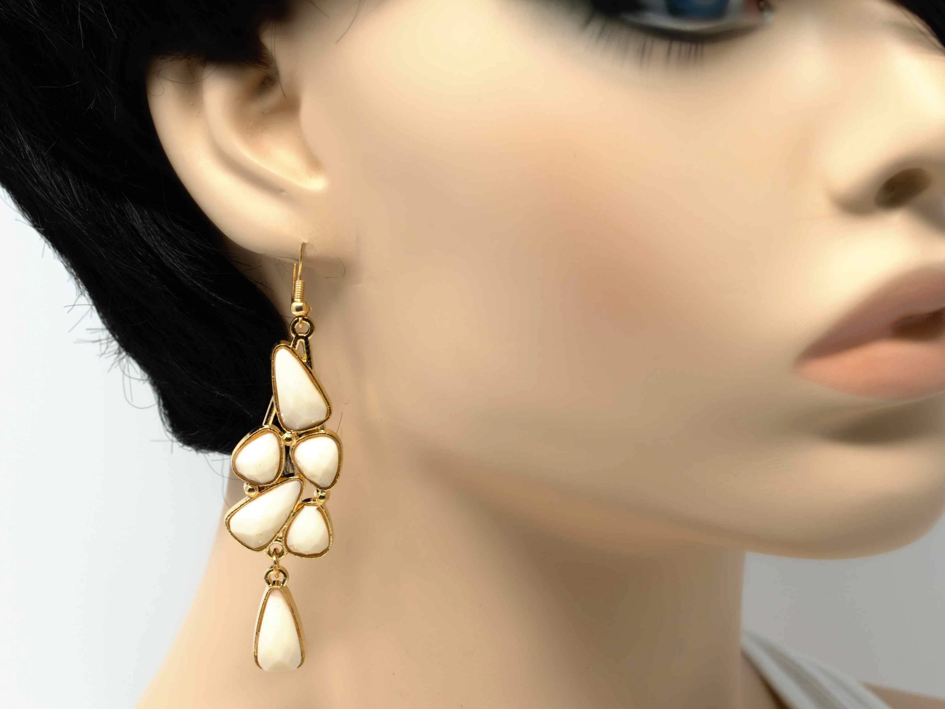 An elegant outstanding gold with white accent stones fashion dangle drop earring. Comes with a fish hook clasp.