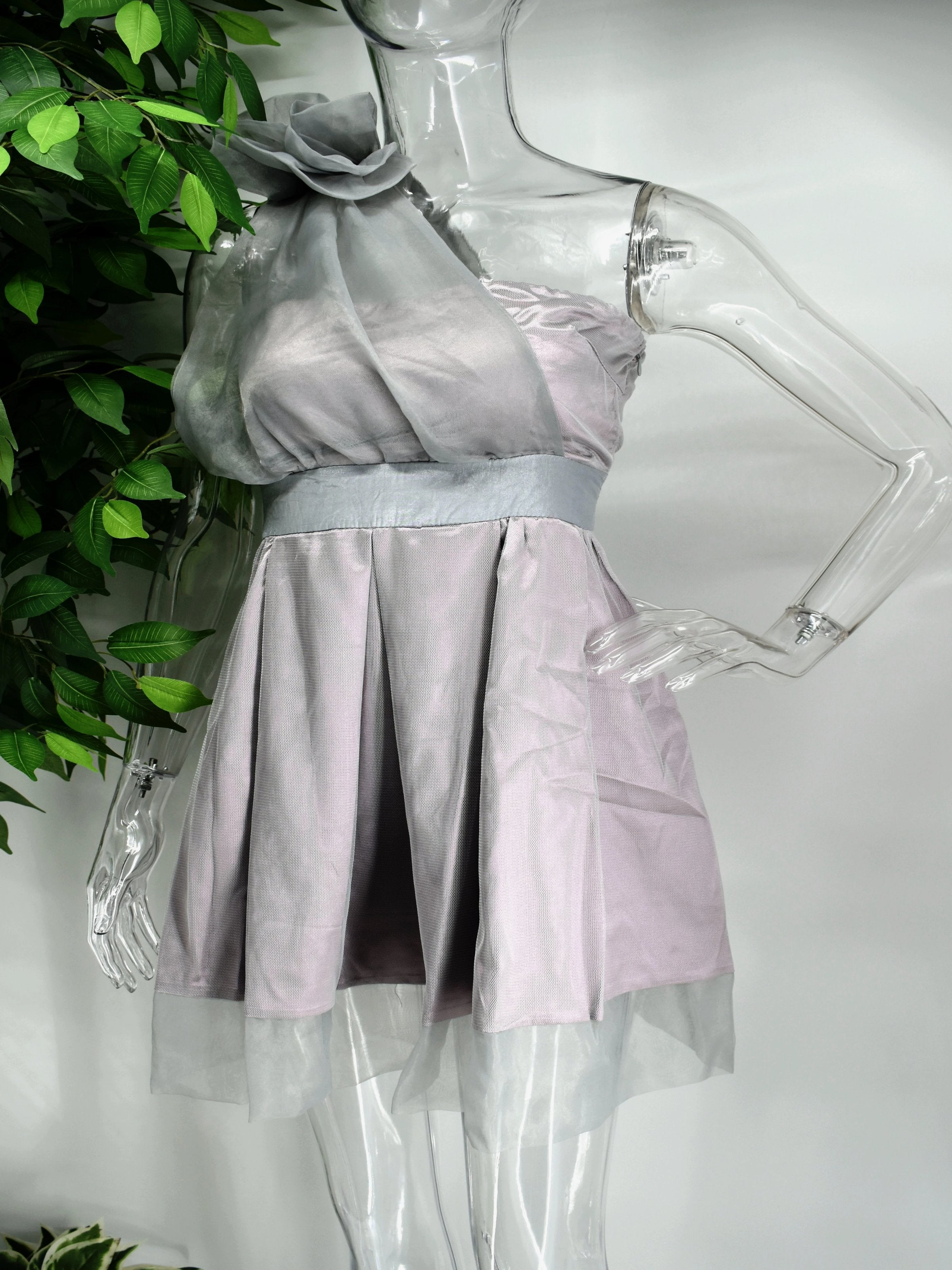 Be the bell of the ball in our Bella fit and flare dress. This strapless  purple and gray dress is an easy crowd pleaser with its cinched waist and flare bottom. The strapless top is accompanied by a sheer sash.