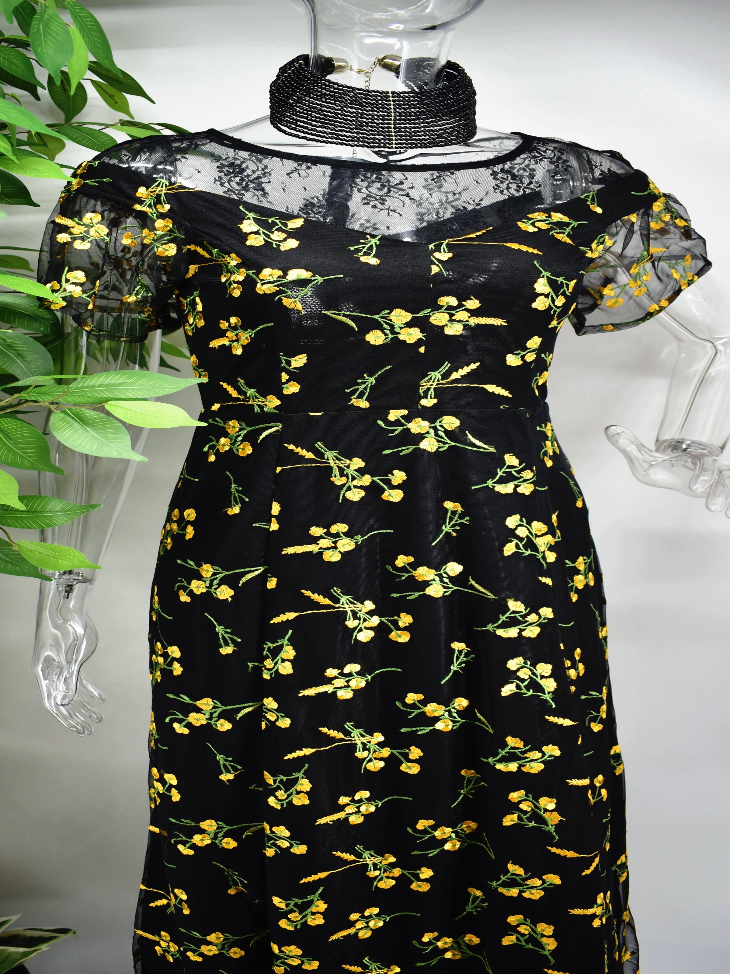 Our Beryle maxi black floral dress is a modern take on a classic silhouette.
