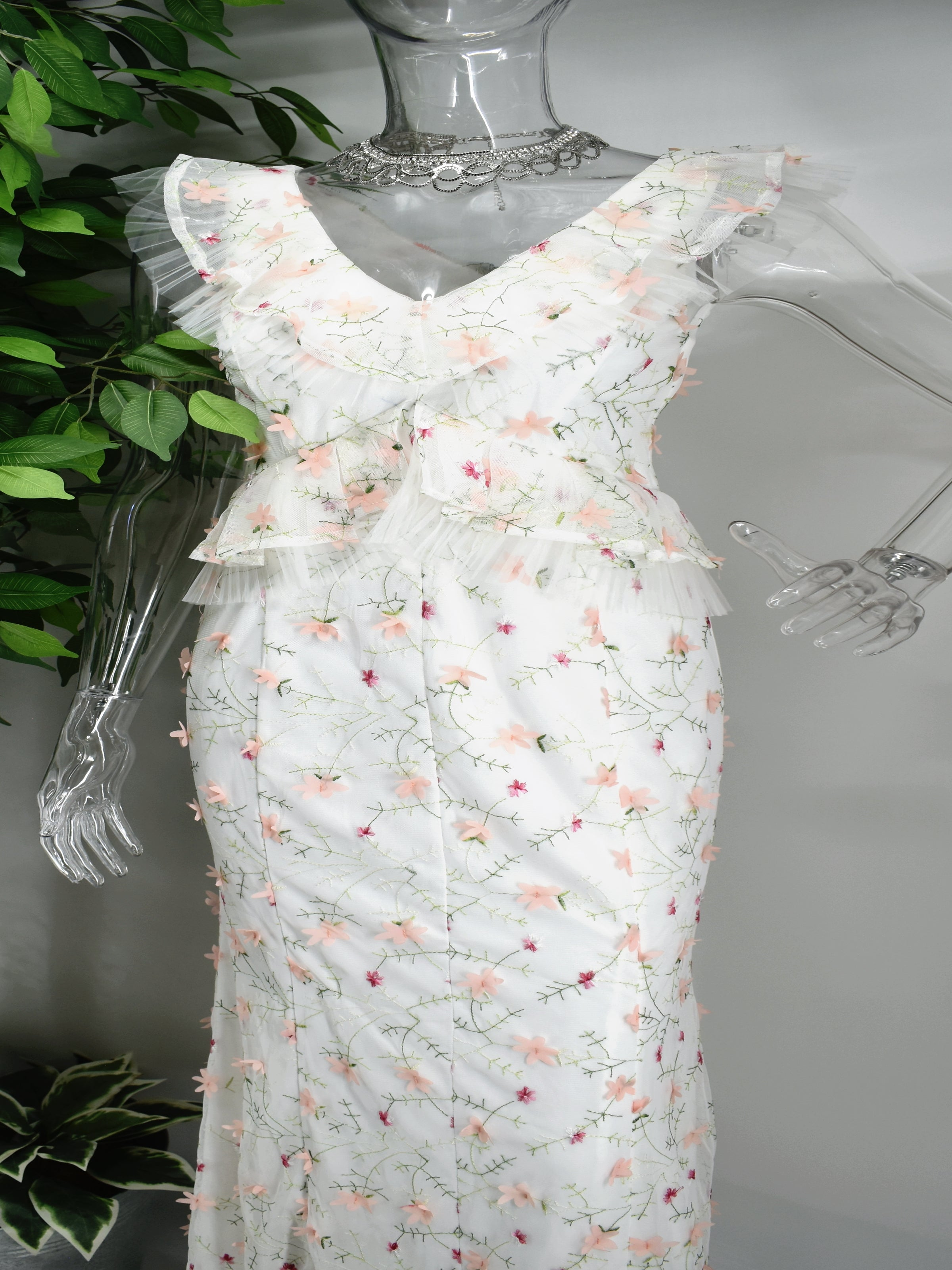 There will be no competing with our Beula long floral dress. Buela is a long  white maxi dress with accented with a floral design. Unique on its own Beula has a ruffled V- neckline cinched bodice also accented with ruffles.