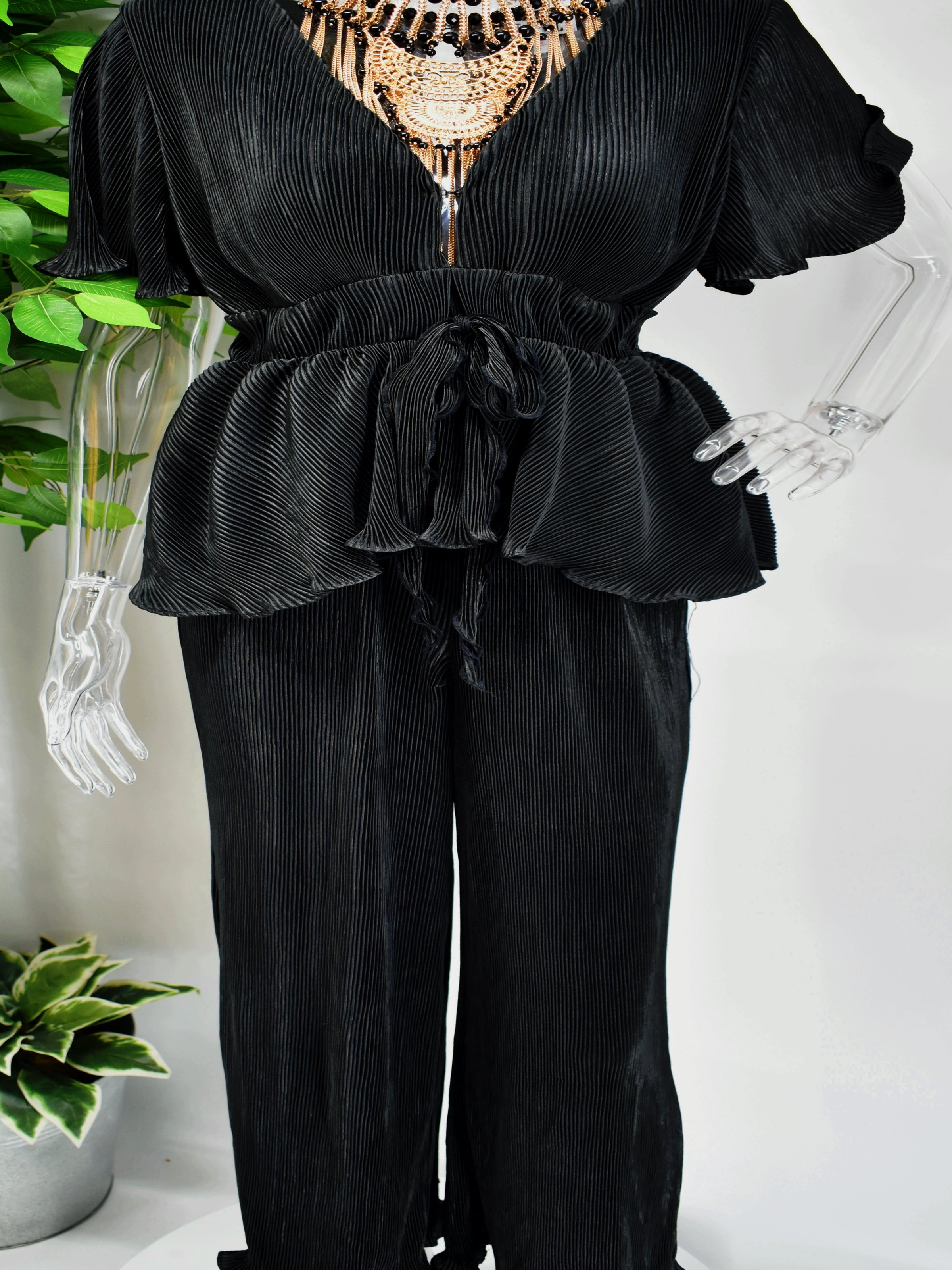 Give a nod to your impeccable taste while you slip on our sensational Bianka Jumpsuit. Our Black Bianka Pants Jumpsuit has a v neckline and short sleeves. The peplum bodice can become as cinched as you would like it with its tied waist.