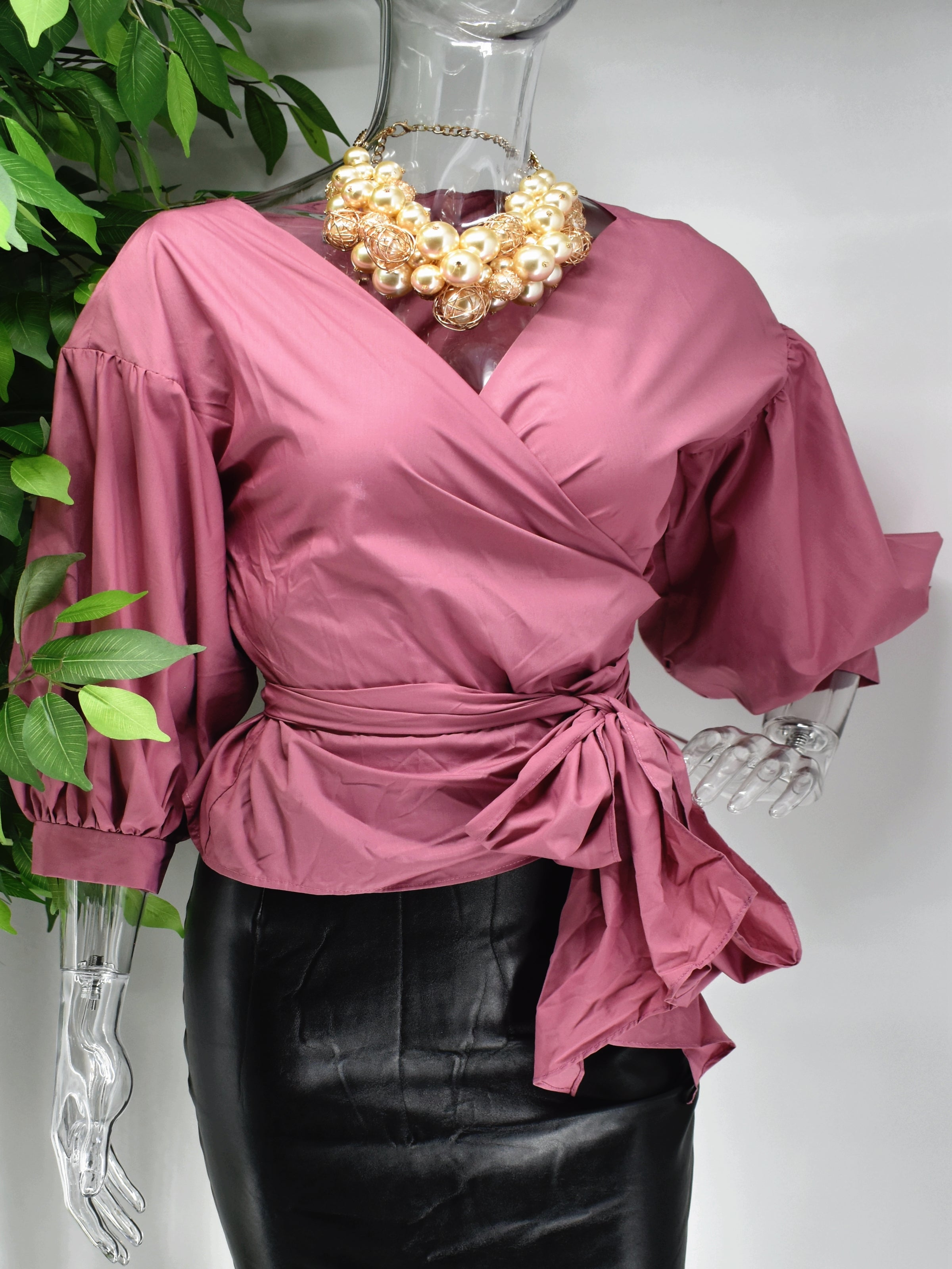 Win them over every time in our chic Bonne mauve wrap top. Our Bonne is a top that wraps around the waist. It has a balloon sleeve and V neckline.